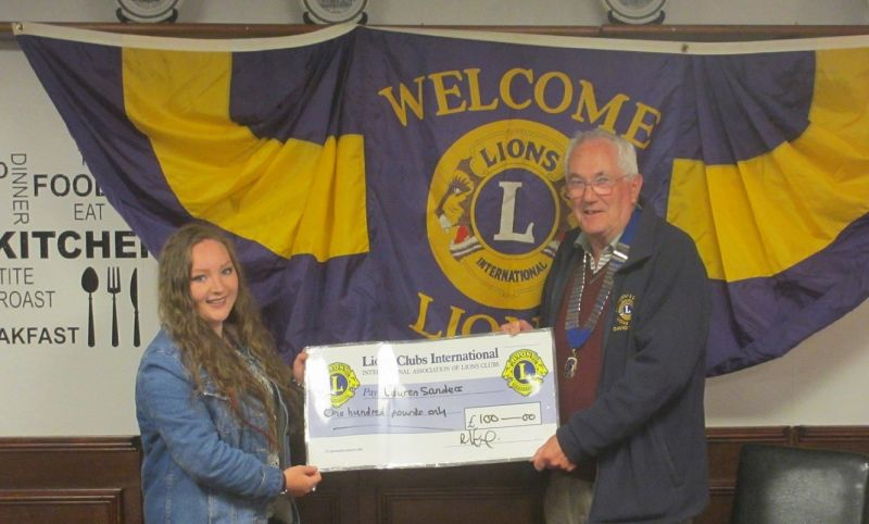 David presenting a cheque to Lauren