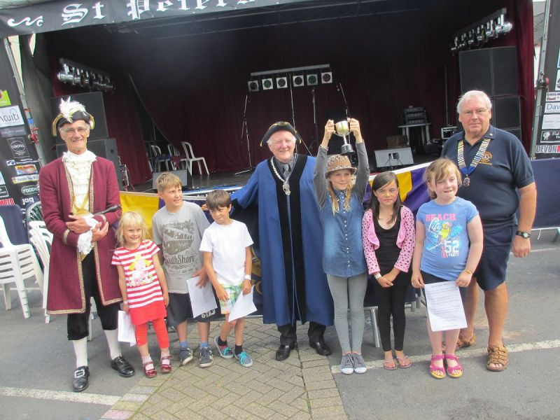 The Junior Town Criers along with the real thing and the Portreeve
